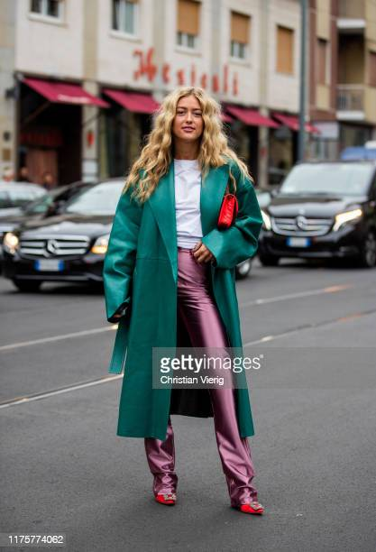 Emili Sindlev wearing pink pants green coat red bag seen outside the Max Mara show during Milan Fashion Week Spring/Summer 2020 on September 19 2019...