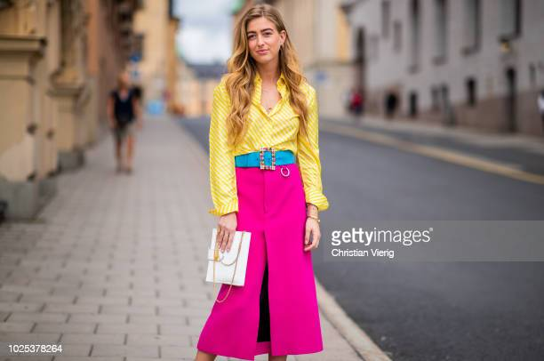 Emili Sindlev wearing pink skirt yellow button shirt during Stockholm Runway SS19 on August 30 2018 in Stockholm Sweden