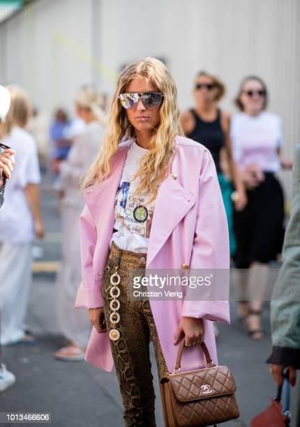 Emili Sindlev wearing pink wool coat is seen outside MUF10 during the Copenhagen Fashion Week Spring/Summer 2019 on August 8 2018 in Copenhagen...