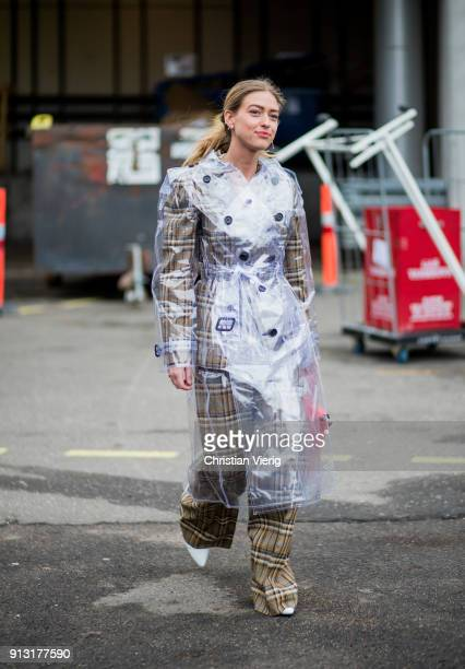 Emili Sindlev wearing sheer rain coat checked wide leg pants and blazer jacket outside Designers Remix during the Copenhagen Fashion Week...