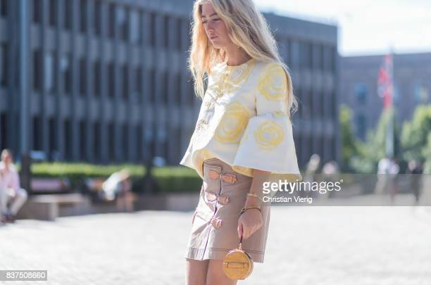 Emili Sindlev wearing skirt with belts boots top mini bag outside IBEN on August 22 2017 in Oslo Norway