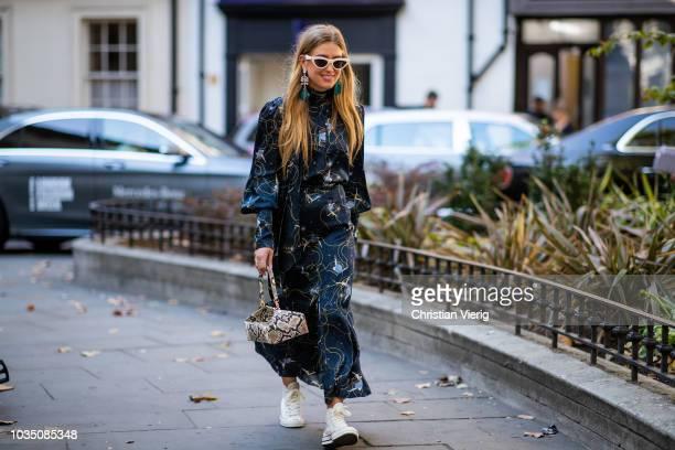 Emili Sindlev wearing snake print bag dress with long sleeves and print is seen outside Erdem during London Fashion Week September 2018 on September...