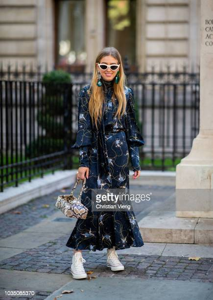 Emili Sindlev wearing snake print bag dress with long sleeves and print is seen outside Erdem during London Fashion Week September 2018 on September...