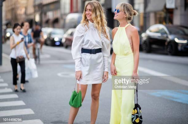 Emili Sindlev wearing white dress with belt and Jeannette Madsen wearing yellow jumpsuit seen outside Baum und Pferdgarten during the Copenhagen...