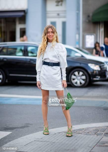 Emili Sindlev wearing white dress with belt is seen outside Baum und Pferdgarten during the Copenhagen Fashion Week Spring/Summer 2019 on August 9...