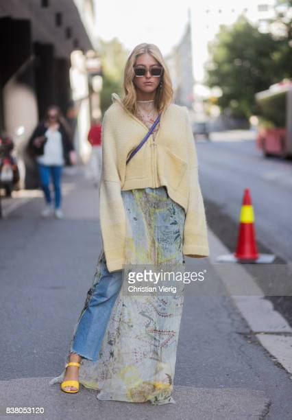 Emili Sindlev wearing yellow cardigan with long sleeves denim jeans outside FWSS on August 23 2017 in Oslo Norway