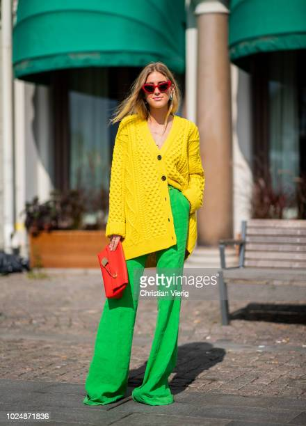 Emili Sindlev wearing yellow knit cardigan green wide leg pants Burberry clutch seen during Stockholm Runway SS19 on August 28 2018 in Stockholm...