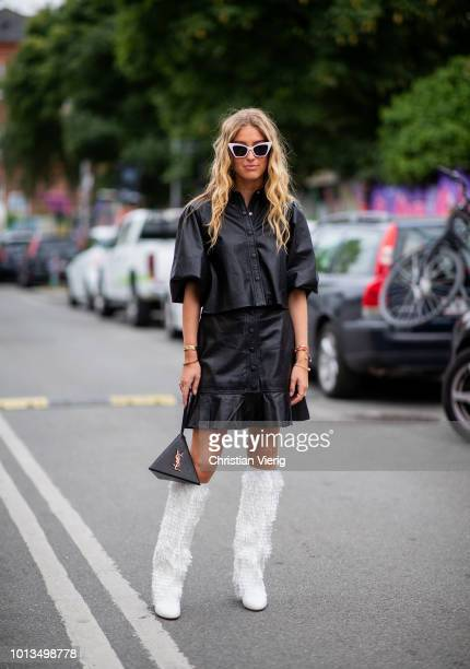 Emili Sindlev wearing YSL triangle bag white boots leather skirt and button shirt is seen outside Stine Goya during the Copenhagen Fashion Week...