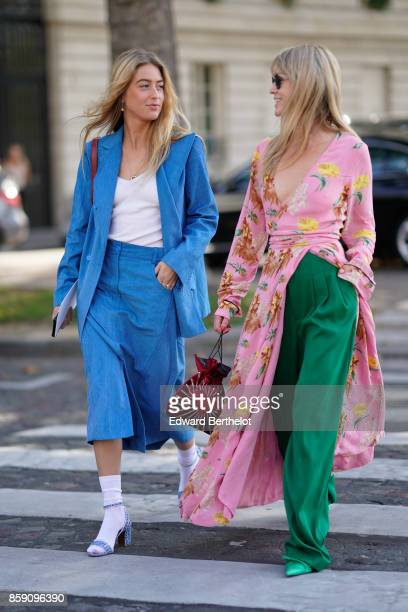 Emili Sindlev wears a blue blazer jacket blue cropped suit pants white socks purple heels Jeanette Madsen wears a floral print pink kimono dres green...