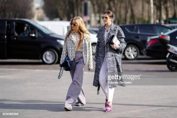 Emili Sindlev wears a Chanel tweed jacket purple flare pants outside Chanel during Paris Fashion Week Womenswear Fall/Winter 2018/2019 on March 6...