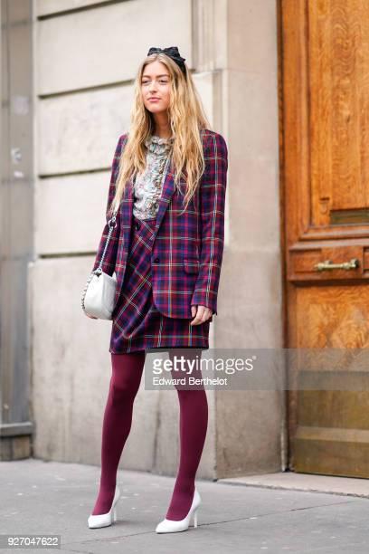 Emili Sindlev wears a tartan checked purple blazer jacket purple tights white shoes a white bag during Paris Fashion Week Womenswear Fall/Winter...
