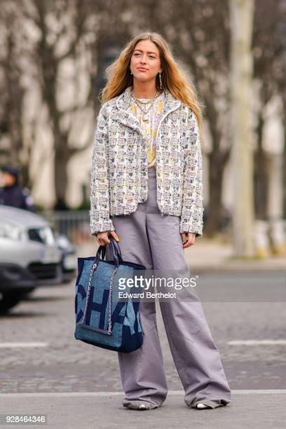 Emili Sindlev wears a tweed Chanel jacket purple flare pants a blue Chanel bag outside Chanel during Paris Fashion Week Womenswear Fall/Winter...