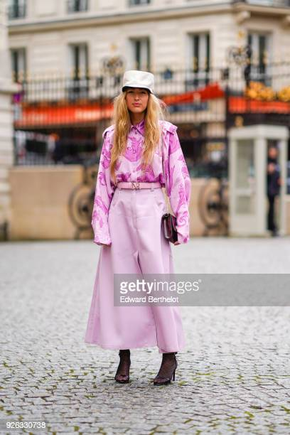 Emili Sindlev wears a white cap a pink print shirt a pink skirt a bag attends the Nina Ricci show as part of the Paris Fashion Week Womenswear...
