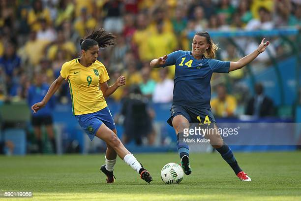 Emilia Appelqvist of Sweden and Andressa Alves of Brazil compete for the ball during the Women's Football Semi Final between Brazil and Sweden on Day...