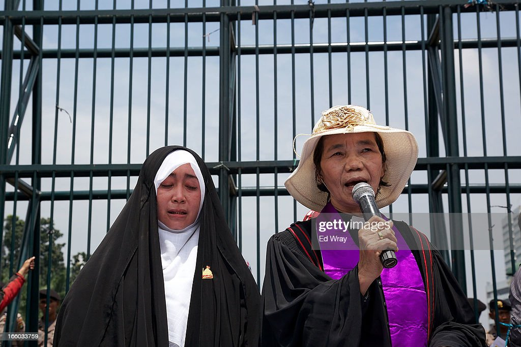 Emilia Az, a member of the Shia community and Anna Menoharan, a Christian pastor speak in front of the Indonesian parliament as Clergy and leaders from Christian and Muslim religious minority groups marched to the parliament to demonstrate for religious tolerance on the streets of Jakarta on April 8, 2013 in Jakarta, Indonesia. Recent reports suggest upwards of 260 violent attacks against religious minorities occured in 2012 in Indonesia.