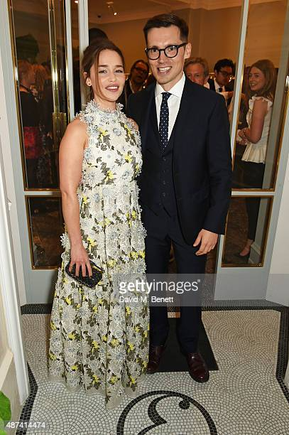 Emilia Clarke and designer Erdem Moralioglu attend the launch of the first Erdem flagship store on September 9 2015 in London England