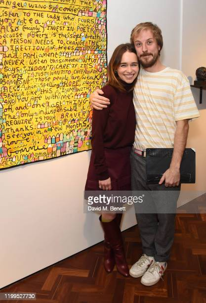 Emilia Clarke and Ollie Gommie attend the Gommie exhibition at Messums London on February 8 2020 in London England