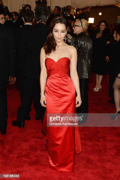 Emilia Clarke attends the Costume Institute Gala for the PUNK Chaos to Couture exhibition at the Metropolitan Museum of Art on May 6 2013 in New York...