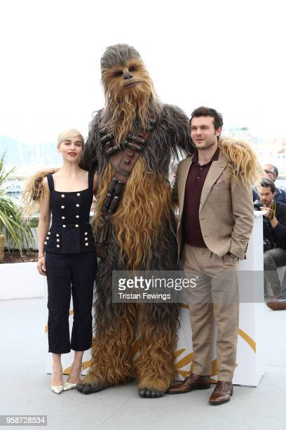 Emilia Clarke Chewbacca and Alden Ehrenreich attend the photocall for 'Solo A Star Wars Story' during the 71st annual Cannes Film Festival at Palais...