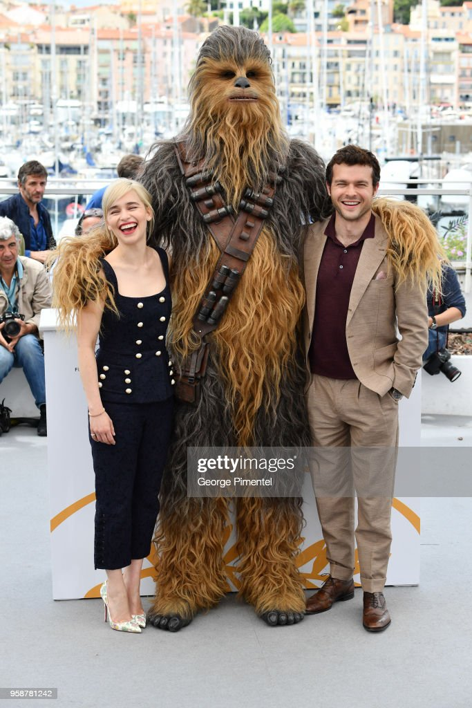 Emilia Clarke, Chewbacca (in costume) and Alden Ehrenreich attend the photocall for 'Solo: A Star Wars Story' during the 71st annual Cannes Film Festival at Palais des Festivals on May 15, 2018 in Cannes, France.