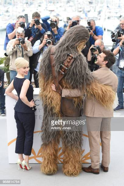 Emilia Clarke Chewbacca and Alden Ehrenreich attend the 'Solo A Star Wars Story' official photocall at Palais des Festivals on May 15 2018 in Cannes...