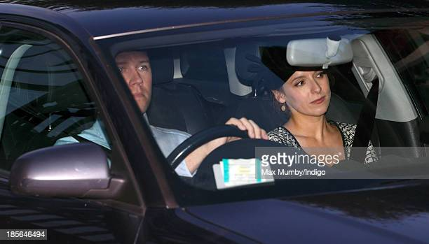 Emilia JardinePaterson accompanied by her husband David JardinePaterson leaves Kensington Palace after earlier attending Prince George of Cambridge's...