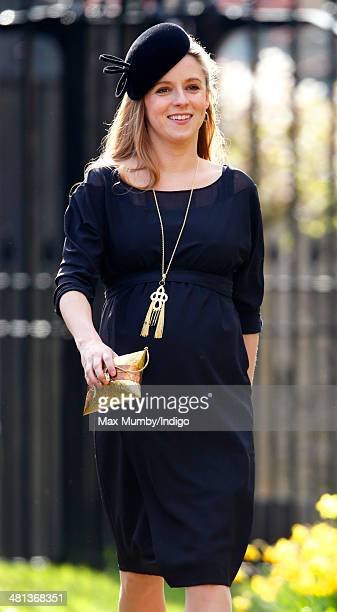 Emilia JardinePaterson attends the wedding of Lucy Meade and Charlie Budgett at the church of St Mary the Virgin Marshfield on March 29 2014 in...
