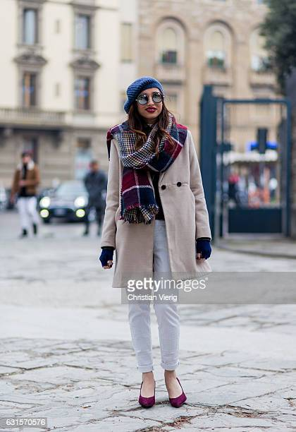 Emilia Liguri is wearing a scarf beanie coat white pants on January 12 2017 in Florence Italy