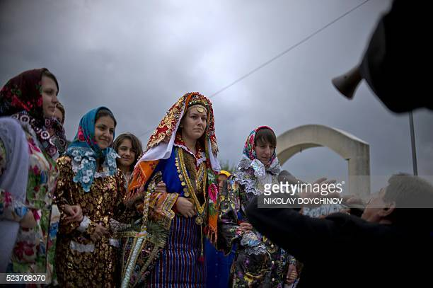 Emilia Pechinkova a 24yearsold Bulgarian Pomak bride is escorted by relatives ands friends during her threeday wedding ceremony in the village of...