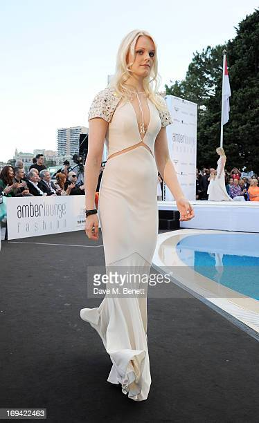 Emilia Pikkarainen walks the runway at Amber Lounge Fashion Monaco 2013 at Le Meridien Beach Plaza Hotel on May 24 2013 in Monaco Monaco