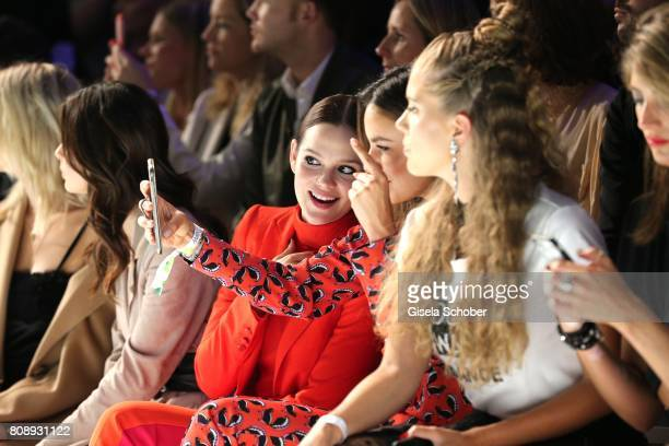 Emilia Schuele Janina Uhse and Victoria Swarovski during the Marc Cain Fashion Show Spring/Summer 2018 at ewerk on July 4 2017 in Berlin Germany