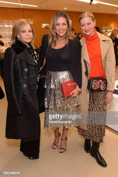 Emilia Silva Ana Ernst and Lisa Marie McComb attend as Barneys New York celebrates Children's Research Fund on October 18 2018 in Chicago Illinois