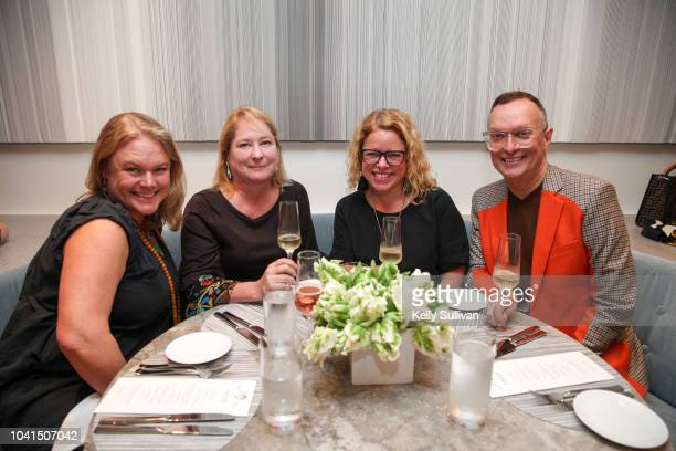 Emilia Weir Carey Sweet Marcia Gagliardi and Scott Goebel pose for a photo at the opening of Freds at Barneys New York San Francisco on September 26...