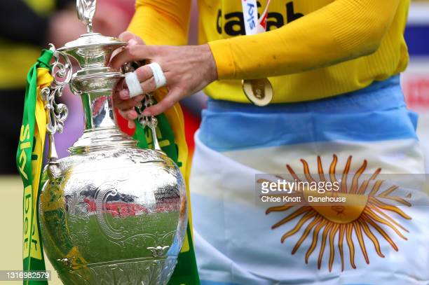Emilian Buendia of Norwich City holds the Sky Bet Championship trophy during the Sky Bet Championship match between Barnsley and Norwich City at...
