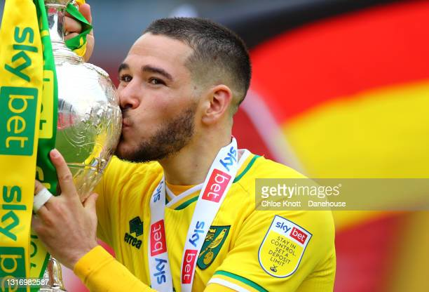Emilian Buendia of Norwich City kisses the Sky Bet Championship trophy during the Sky Bet Championship match between Barnsley and Norwich City at...