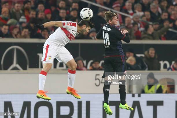 Emiliano Adrian Insua Zapata of Stuttgart and Marlon Ritter of Fortuna Duesseldorf battle for the ball during the Second Bundesliga match between VfB...