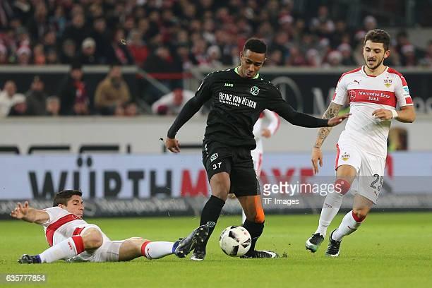 Emiliano Adrian Insua Zapata of Stuttgart Noah Joel Sarenren Bazee of Hannover 96 and Matthias Zimmermann of Stuttgart battle for the ball during the...