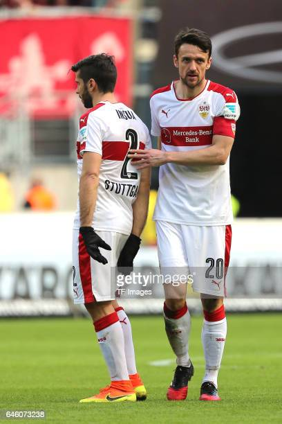 Emiliano Adrian Insua Zapata of Stuttgart shakes hands with Christian Gentner of Stuttgart during the Second Bundesliga match between VfB Stuttgart...