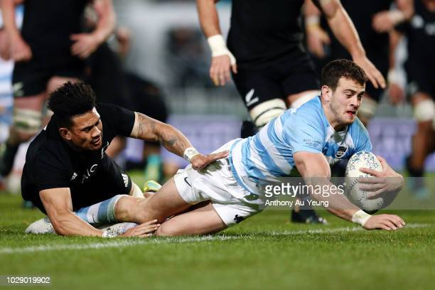 Emiliano Boffelli of Argentina scores a try against Ardie Savea of the All Blacks during The Rugby Championship match between the New Zealand All...