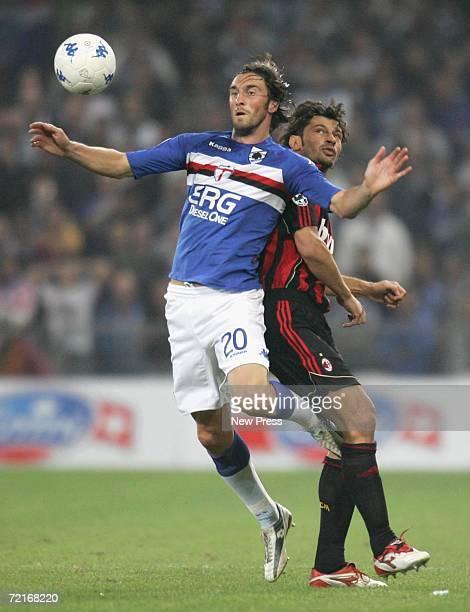 Emiliano Bonazzoli of Sampdoria competes with Kakha Kaladze of Milan during the Serie A match between Sampdoria and AC Milan at Luigi Ferraris...