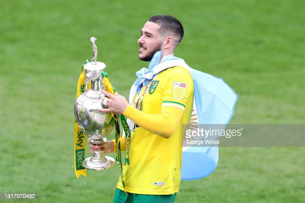 Emiliano Buendia of Norwich City celebrates with the Sky Bet Championship trophy following the Sky Bet Championship match between Barnsley and...