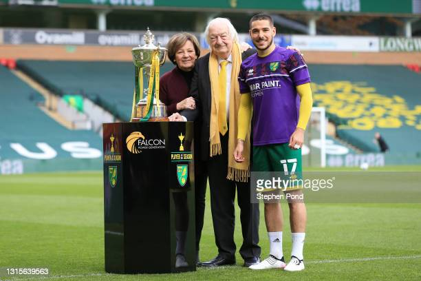 Emiliano Buendia of Norwich City is presented with the Norwich Player of the Season award by Owners Delia Smith and Michael Wynn-Jones prior to the...
