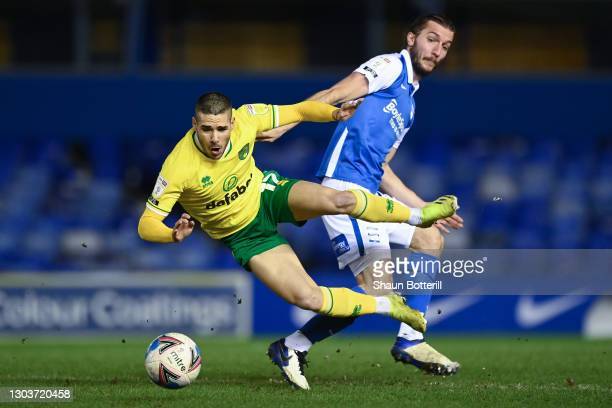 Emiliano Buendia of Norwich City is tackled by Ivan Sunjic of Birmingham City during the Sky Bet Championship match between Birmingham City and...