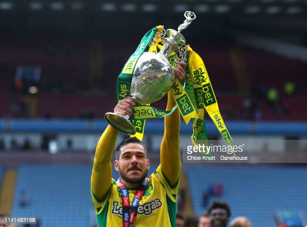 Emiliano Buendia of Norwich City lifts the trophy after winning the Sky Bet Championship match between Aston Villa and Norwich City at Villa Park on...