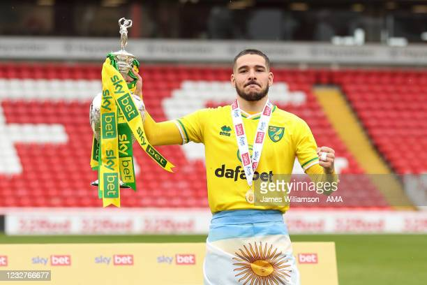 Emiliano Buendia of Norwich City poses with the Sky Bet Championship trophy during the Sky Bet Championship match between Barnsley and Norwich City...