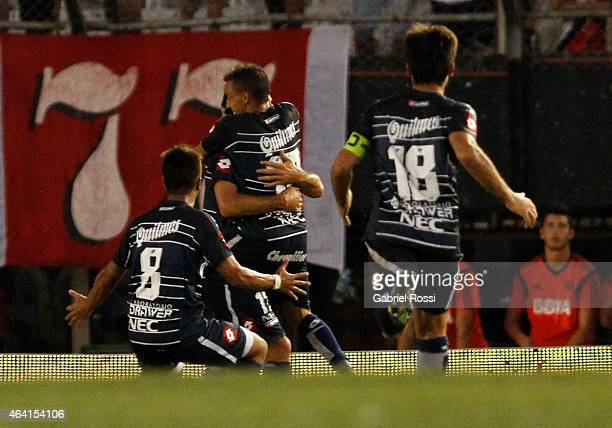 Emiliano Carrasco of Quilmes celebrates with his teammates after scoring the tying goal of the match against River Plate as part of second round of...