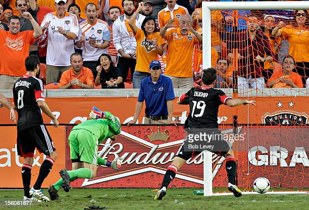 Emiliano Dudar of the DC United attempts clear the ball as it crosses the goal line on a shot by Will Bruin of the Houston Dynamo in the second half...