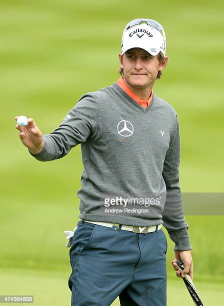 Emiliano Grillo of Argentina acknowledges the crowd after an eagle on the 18th hole during day 2 of the BMW PGA Championship at Wentworth on May 22...