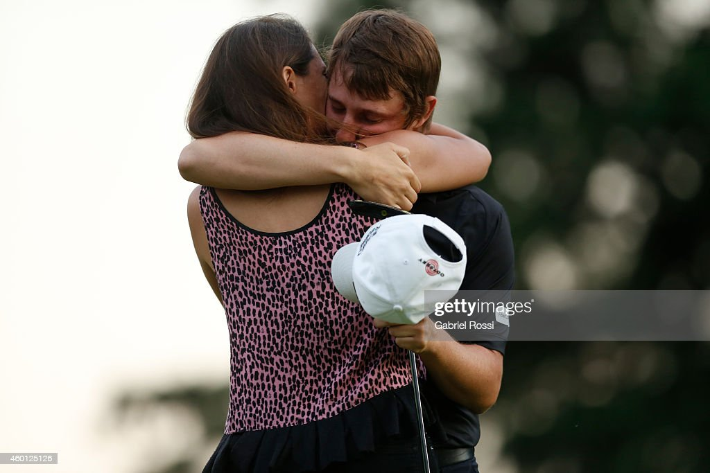 Emiliano Grillo of Argentina celebrates with her girldfriend after winning the 109th VISA Open Argentina as part of PGA Latinoamerica tour at Martindale Country Club on December 07, 2014 in Buenos Aires, Argentina.