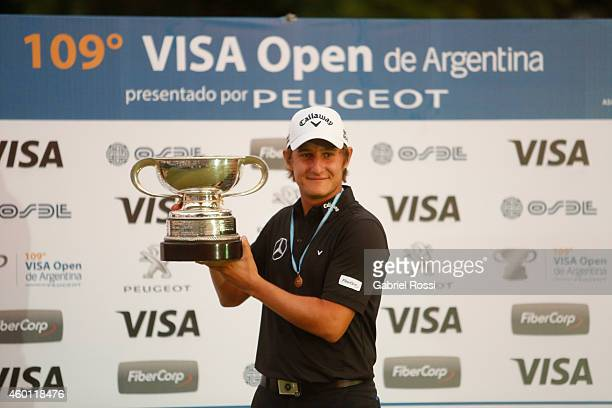 Emiliano Grillo of Argentina celebrates with the trophy after the closing day of the 109th VISA Open Argentina as part of PGA Latinoamerica tour at...